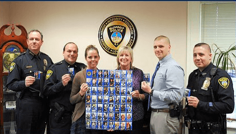 Officers of the Summit PD pose with their trading cards