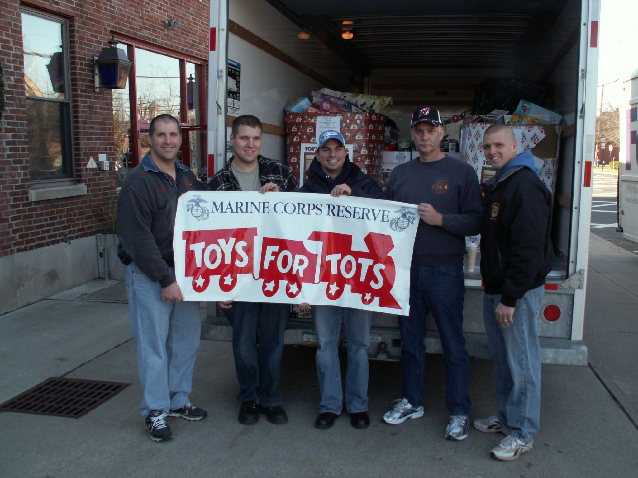 Group holding Toys for Tots sign
